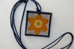 Surface-gilt parchment pendant