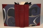 A half-leather binding with maroon leather and marbled paper, the title blind-tooled on the spine