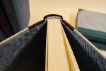 Detail of a sewn two-color headband on one of the Alas Books
